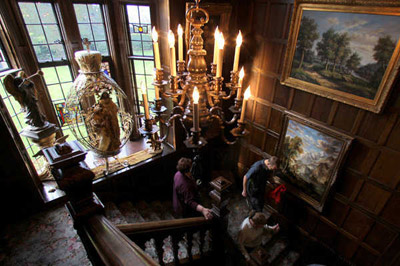 The oak staircase is one of the features Chester Thorne brought to his American lake castle from a 400-year-old Elizabethan manor he purchased in England in 1907.  (Photos by Janet Jensen/Staff Photographer)