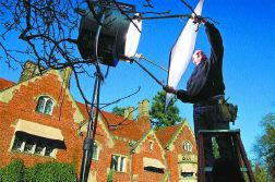 Chris Goodenow | The News Tribune Grip Martin Camera adjusts a light on the set of the ABC movie 'The Diary of Ellen Rimbauer,' as Lakewood's Thornewood Castle towers behind him.