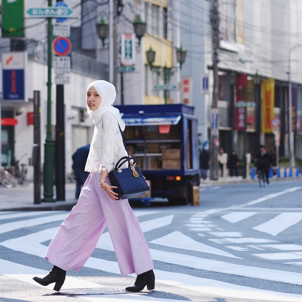 Chasing adventures in style. Wearing Lychee Duck Scarf, white top from libby and Rose Japan, Kai Culotte from FV basic and boots I purchased from Shibuya 109. Picture by  Izzy Osman
