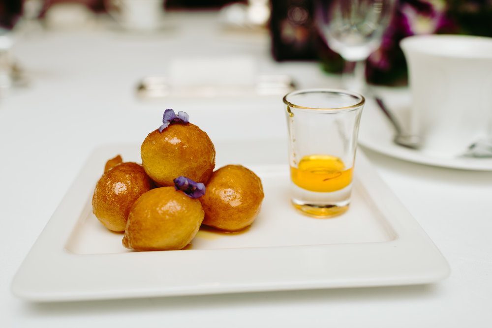 A sweet flour-based dumpling infused saffron and paired with a honey drizzle.