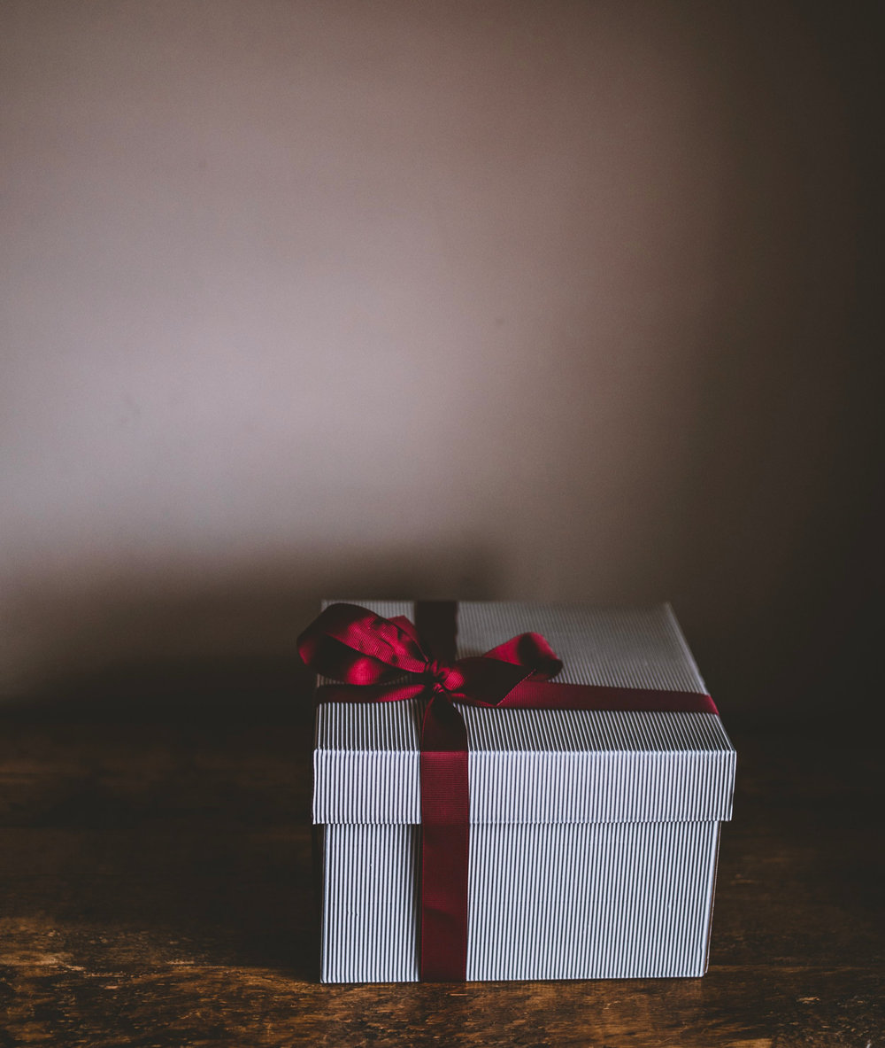 Giving the gift of evaluation. Photo by  Annie Spratt  on  Unsplash