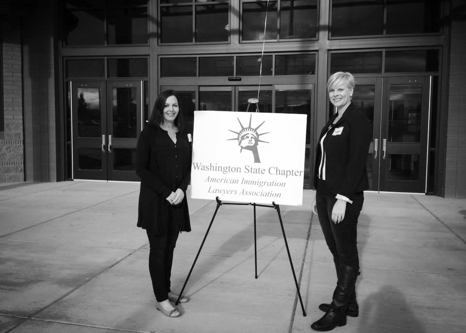 Shannon Underwood with law firm partner Erin Hall volunteering at a legal clinic in Pasco, WA