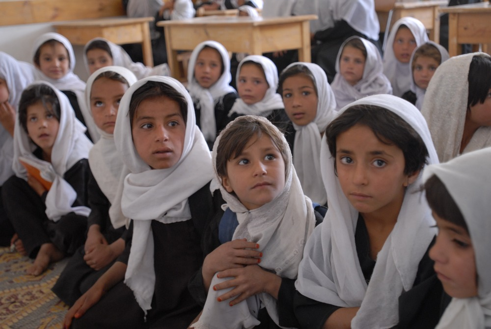 Children sit inside of a school in Afghanistan. Currently, MEJA has loopholes that may protect non-military contractors if they were to be implicated of war crimes.
