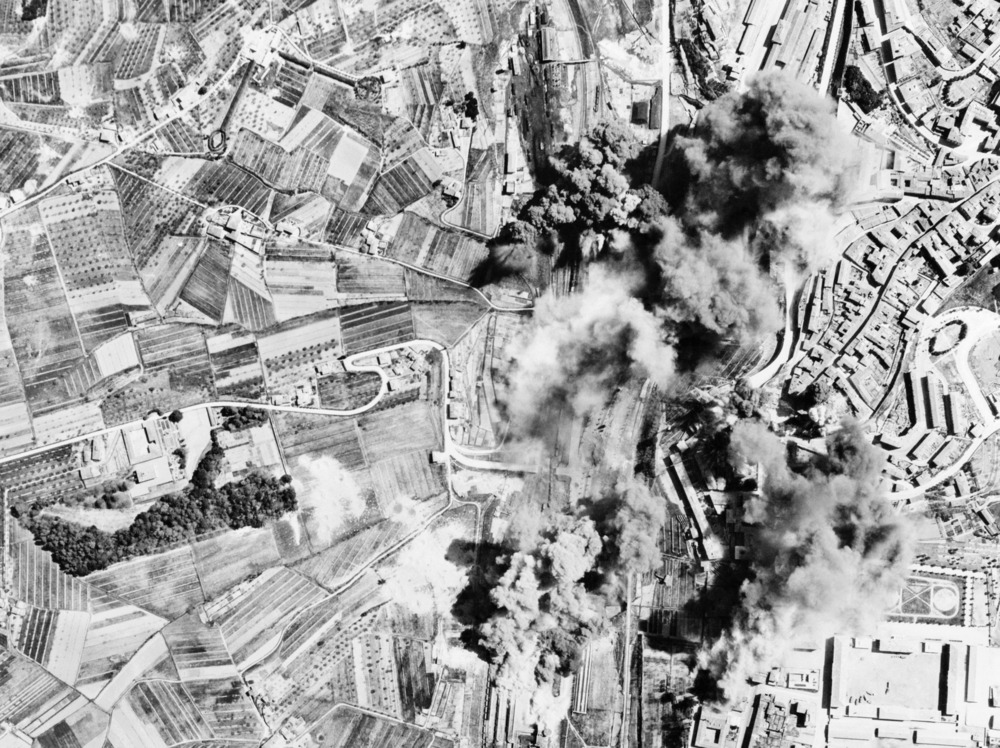 Aerial photograph of explosions as bombs were dropped from aircraft onto cities in Italy.