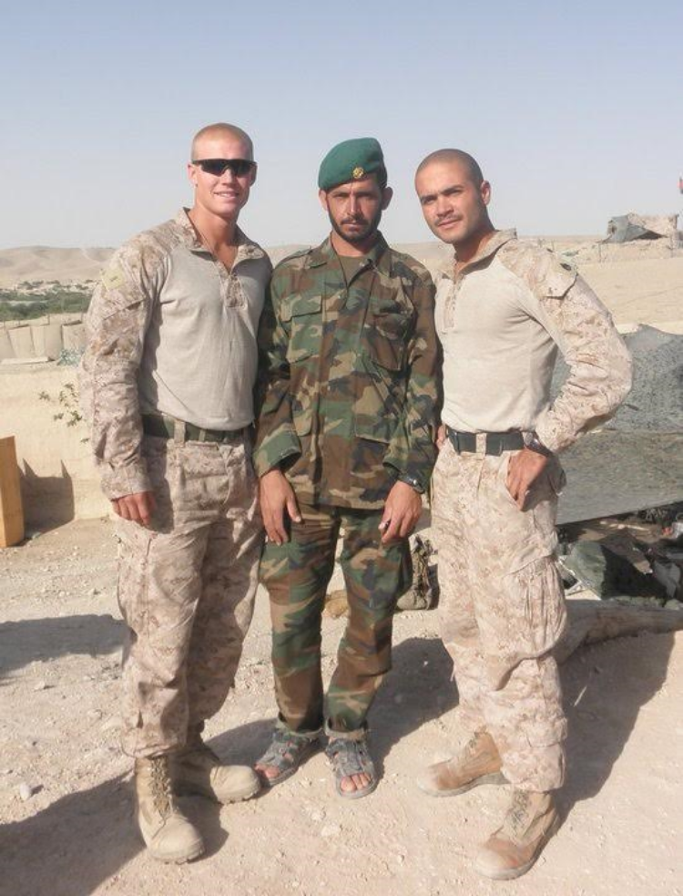 Second Lt. Jason Blydell, left, and Staff Sgt. Javier Ortiz Rivera, right,  stand beside a member of the Afghanistan National Army near Patrol Base Griffin in Helmand Province Afghanistan. Photo courtesy of Veronica Ortiz Rivera.