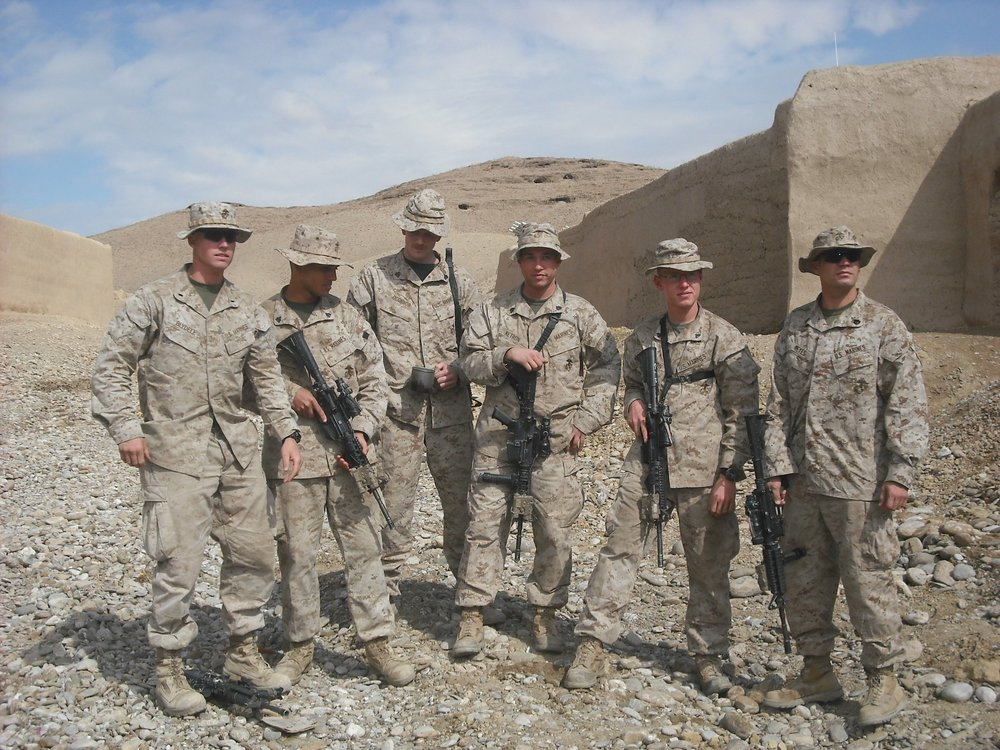Second Lt. Jason Blydell, far left, and Staff Sgt. Alex Reyes, far right, stand with the four squad leaders of Second Platoon. Photo courtesy of Veronica Ortiz Rivera.
