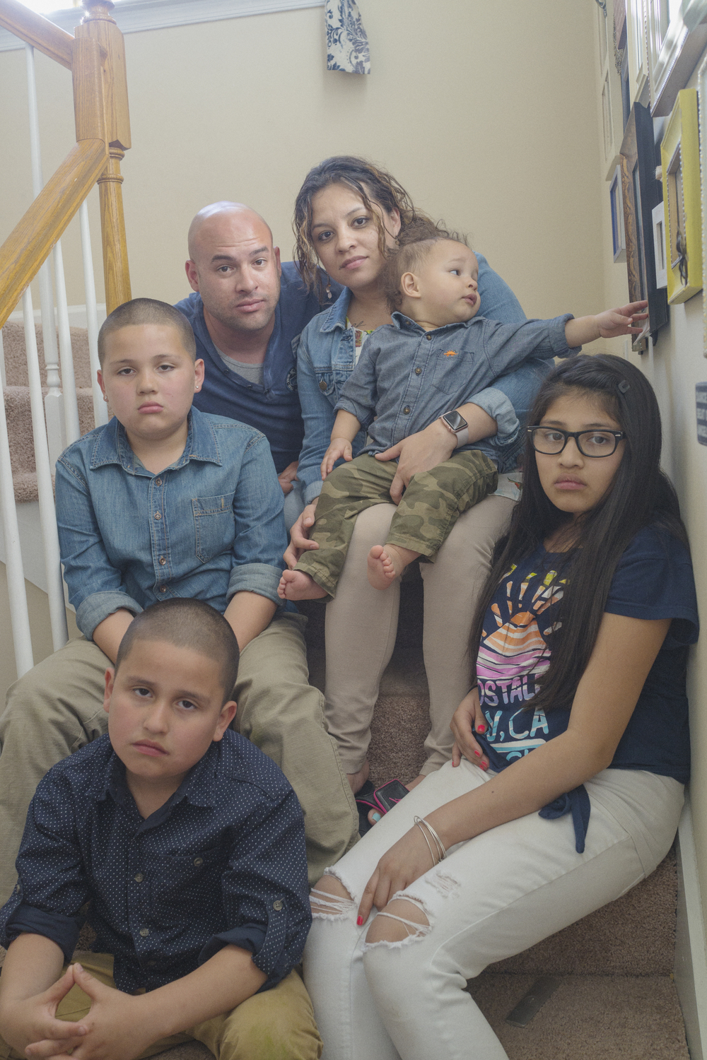 """A family portrait of the Ortiz Rivera family in Williamsburg, Virginia on April 16, 2016, nearly six years after the death of Javier Ortiz Rivera, who was killed in action in Afghanistan in 2010. Bottom Left, Anthony Ortiz Rivera, 8, above Andrew Ortiz Rivera, 11, Juan """"Junior"""" Vasquez Jr., Veronica Ortiz Rivera, Kaleb Vasquez, 16 months and Alyssa Ortiz Rivera."""
