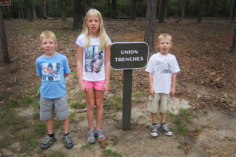 The Lingle Family explores Union trenches at Cold Harbor, Hanover County, VA. Photo courtesy of Brandon Lingle.
