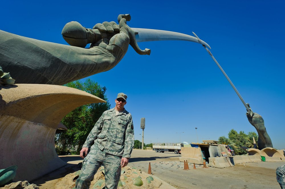 Brandon Lingle stands beneath the Swords of Qādisiyyah in Baghdad, Iraq. Photo courtesy of Brandon Lingle.
