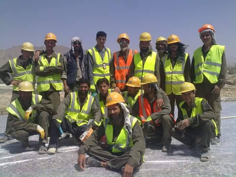Zabi stands with a team of workers for Azrakhsh Construction in Afghanistan. Photo courtesy of Tim Patterson.