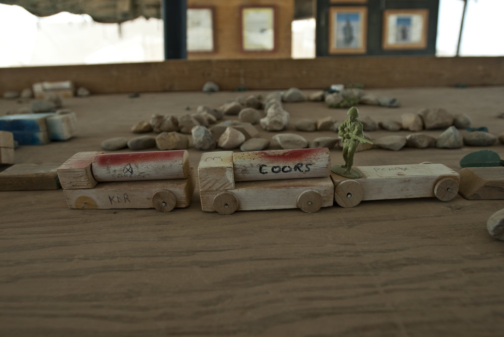 A sand table marks the route of an upcoming mission. Taken at Contingency Operating Base Adder in Iraq in 2009.  Photo courtesy of J.P. Lawrence.