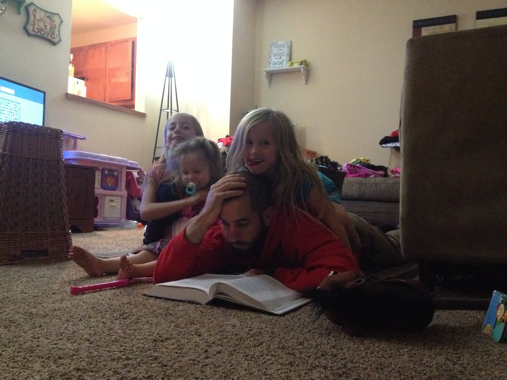 The Hefti girls help their dad study contract law in Madison, Wisconsin, in 2014. Photo courtesy of Matthew Hefti.