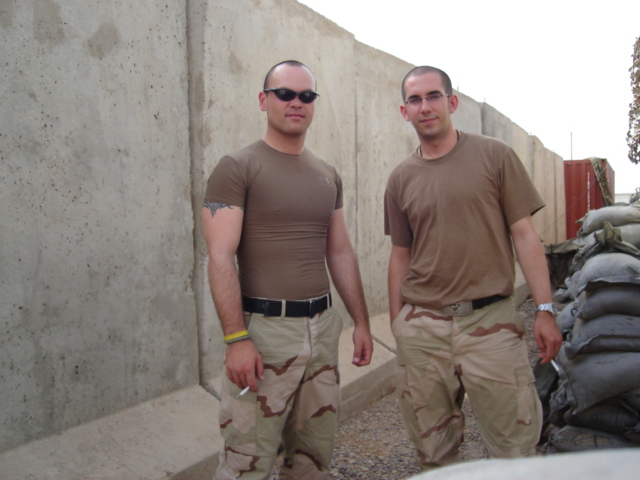 Nate Anhalt and Matthew Hefti share a cigarette at FOB O'Ryan, Iraq, in the summer of 2005. Photo courtesy of Matthew Hefti.