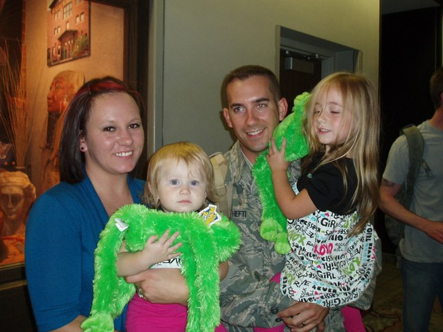Matthew Hefti is welcomed home from Afghanistan by his wife and daughters in Wichita, Kansas, in 2009. Photo courtesy of Matthew Hefti.