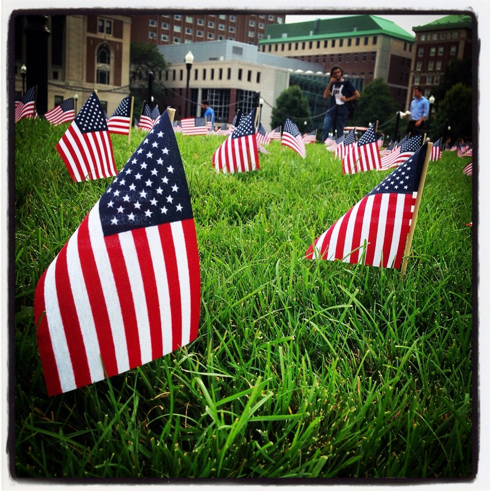 Thousands of small American flags memorialize September 11th on the Columbia University campus. Photo by Anna Hiatt.