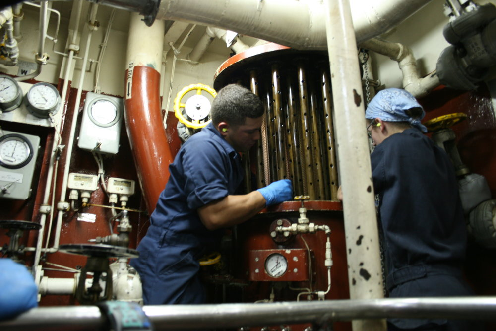 Cadet Tenley Barna and a mechanic change the fuel filters for USCGC Morgenthau in 2007. Photo courtesy of Tenley Lozano.