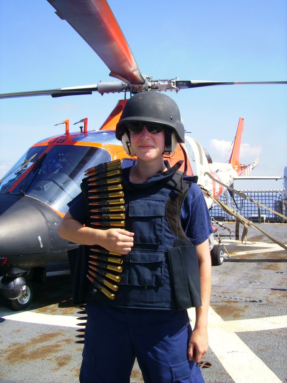Cadet Tenley Barna on the flight deck of USCGC Morgenthau following a .50 caliber machine gun training exercise in 2007. Photo courtesy of Tenley Lozano.