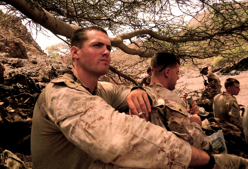 William Gehrung sits with fellow Marines in his squad during a 2013 deployment to Djibouti. Photograph courtesy of William Gehrung.