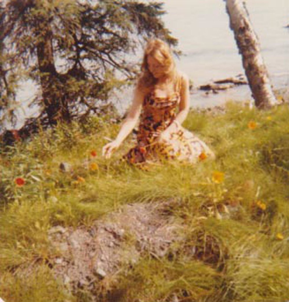 Elizabeth O'Herrin's mother picks a poppy flower in Moose Pass, Alaska, August 1978. Photo courtesy of Elizabeth O'Herrin