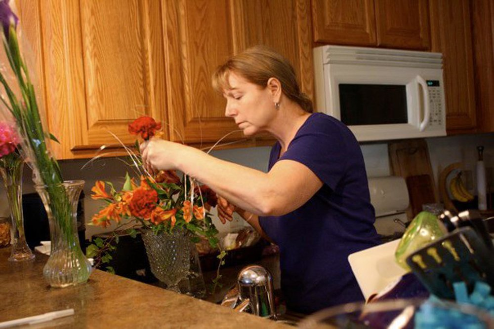 Elizabeth O'Herrin's mother arranges flowers. Photo courtesy of Elizabeth O'Herrin