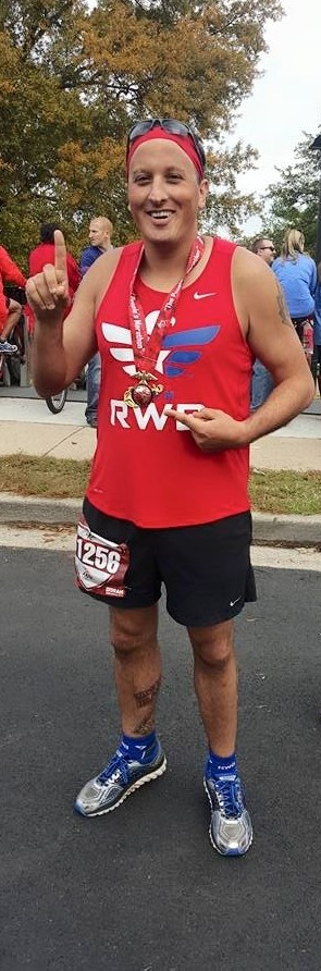 Mike Goranson poses for a picture after finishing the Marine Corps Marathon in Washington, D.C. in October 2015.