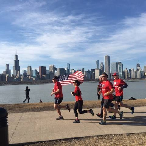 Mike Goranson, seen here holding the American flag, leads a group of Team RWB Eagles on a run along Lake Michigan in Chicago, Ill.