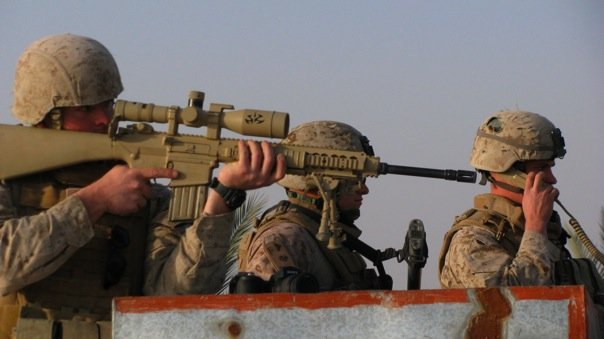 Members of Jones's platoon conducting overwatch in Iraq. Courtesy: Dustin Jones