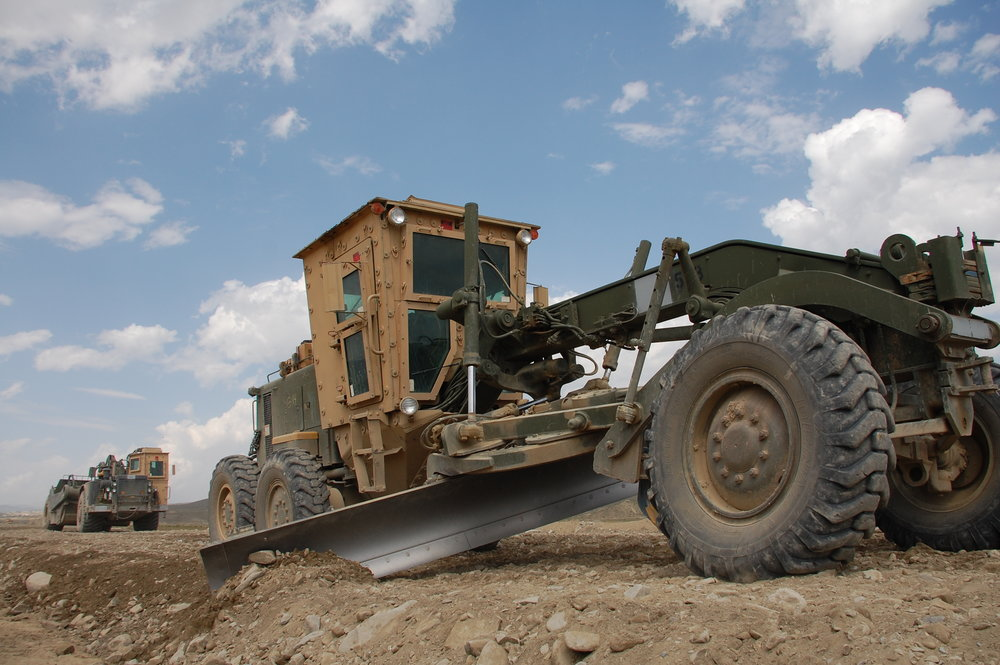 Military construction equipment works to build a road in Paktika Province, Afghanistan. Photo by Dan Bellis