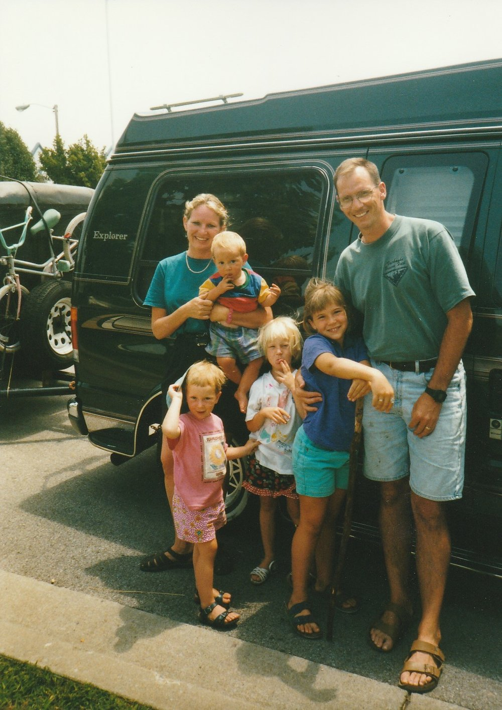 John Sims and his wife, Theresa, and their children on moving day. Courtesy of John Sims