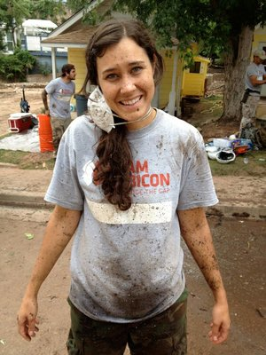 "Gina covered in the dreaded ""fecal freckles"", mud mixed with raw sewage, after spraying down equipment Courtesy of Elizabeth O'Herrin"