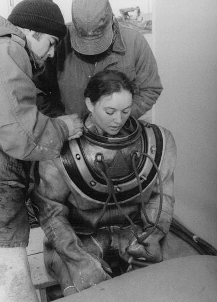 Donna Tobias, the first woman to become a Navy Diver, wearing Mk V Dive Equipment in 1975. Archival image.