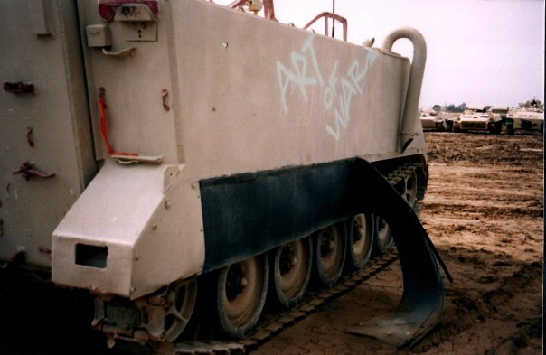 "An abandoned tank near Al Taji, where a creative soldier had sprayed ""The Art of War"" on the side. Courtesy of Lyndsey Anderson"