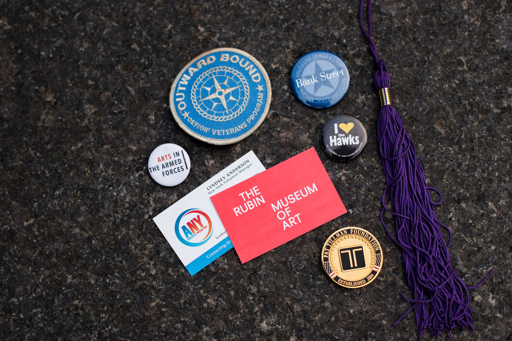 Trinkets and medals from Lyndsey's service in various organizations, including her graduation tassel from NYU and her business cards from various jobs in NYC. Photo by Jack Crosbie for The War Horse