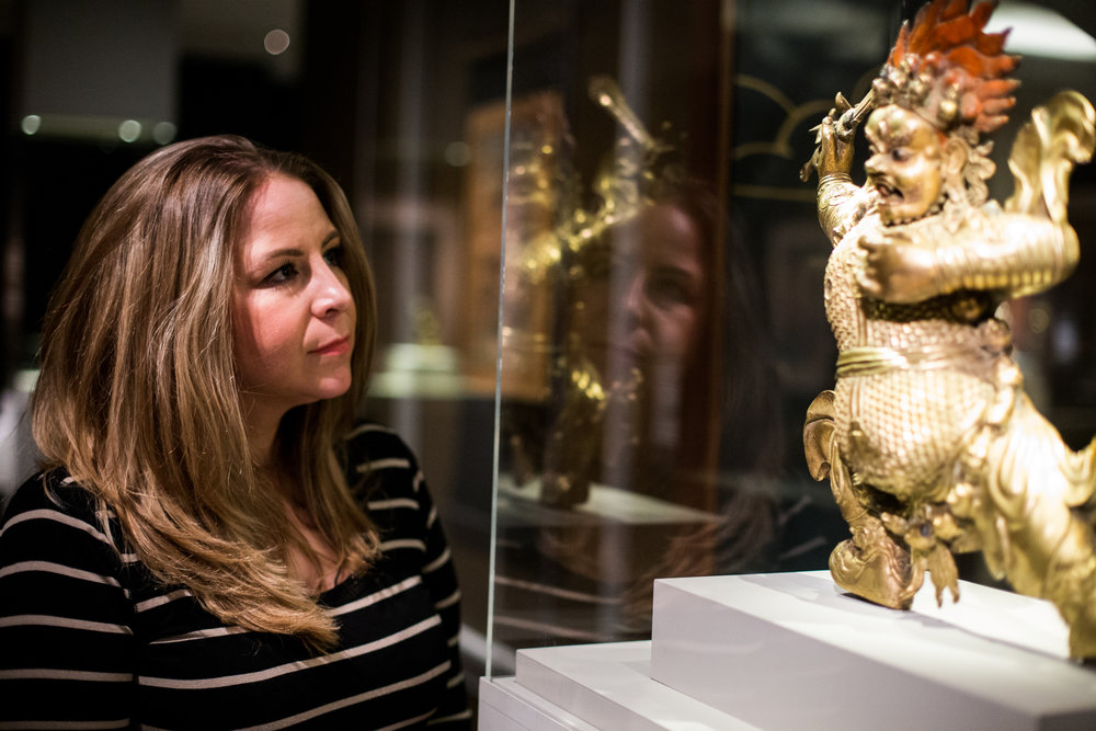 Lyndsey looks at a statue in the Rubin Museum, where she worked managed the accessibility programs for guests with visual, physical, or cognitive impairments. Photo by Jack Crosbie for The War Horse