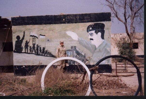 Portraits of Saddam Hussein, like this one on an external architectural wall, were all over Lyndsey's post. Courtesy of Lyndsey Anderson