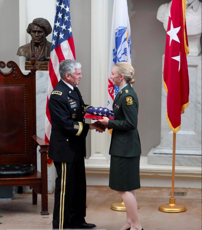 The author shakes hands with General Casey during her commissioning ceremony. Courtesy of Nina Semczuk