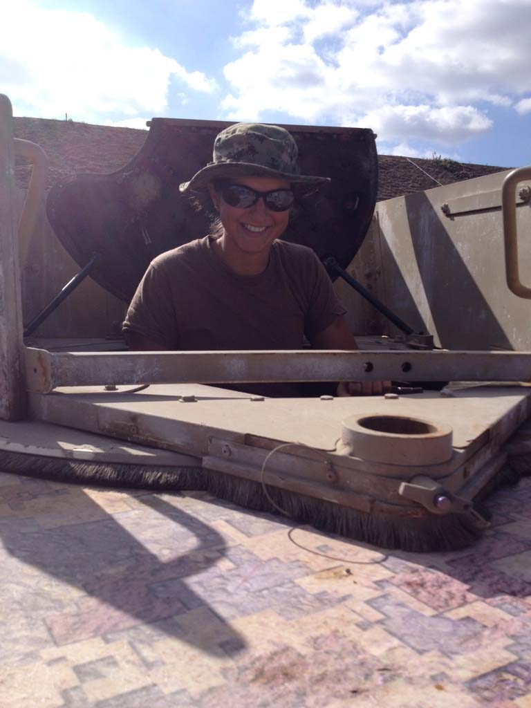The author, Andrea N. Goldstein, takes a break in the turret of a Humvee during a training event in California. Courtesy Andrea N. Goldstein