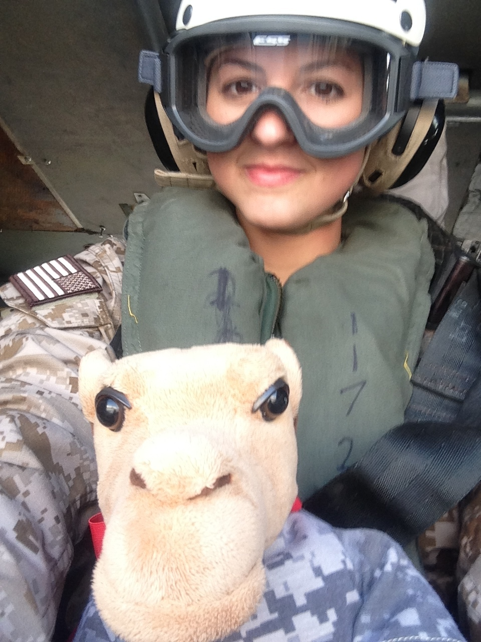 The author takes her traveling companion, Humps the Camel, for a helicopter ride, while deployed on Christmas Eve 2013. Courtesy Andrea N. Goldstein