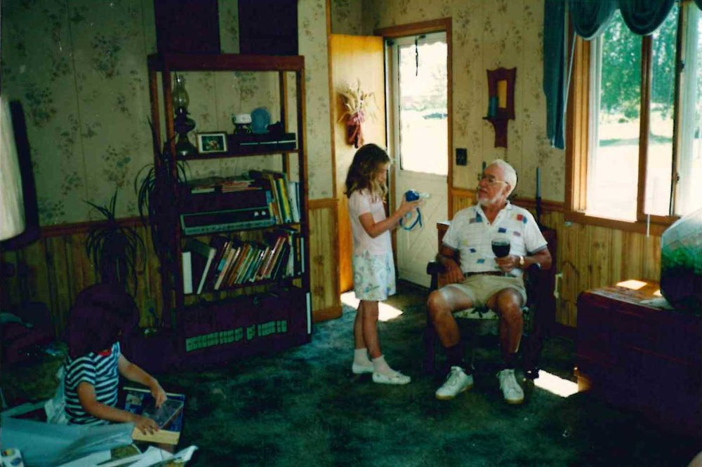 The author, Elizabeth O'Herrin, demonstrates a new toy for her grandfather at their home in Wisconsin, in the summer of 1991. Courtesy of Elizabeth O'Herrin