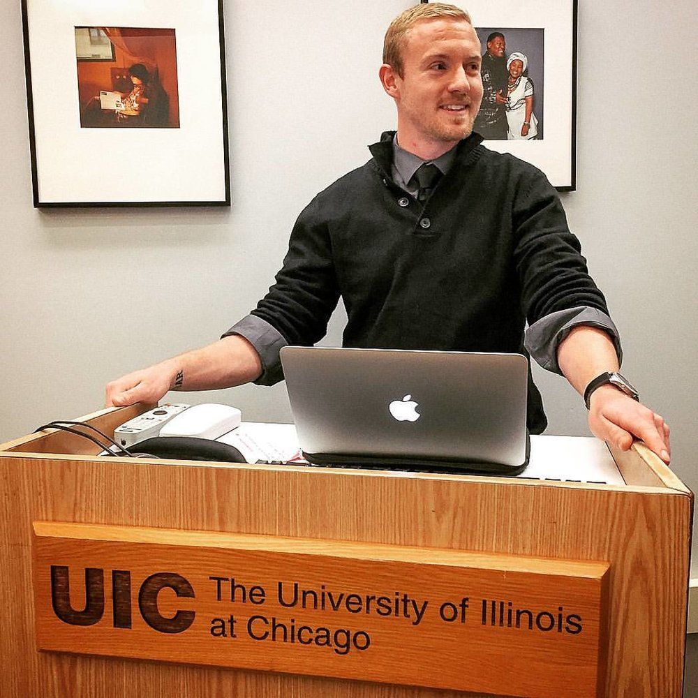 Sgt. Scott Reel, former United States Marine Corps combat correspondent, presenting his thesis prior to graduating with a degree in english and philosophy at the University of Illinois Chicago in 2017. Courtesy of Scott Reel