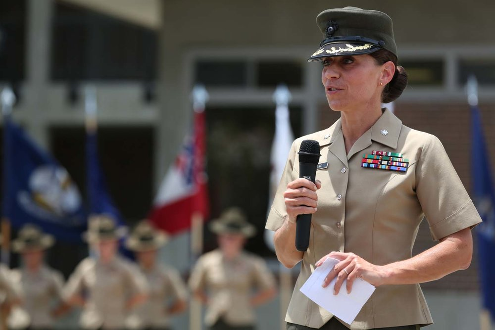 U.S. Marine Lt. Col. Kate I. Germano, battalion commander, addresses the audience during the 4th Battalion relief and appointment ceremony aboard Marine Corps Recruit Depot Parris Island, S.C., July 18, 2014. Courtesy U.S. Marine Corps photo by Lance Cpl. Allison Lotz MCRD Parris Island Combat Camera