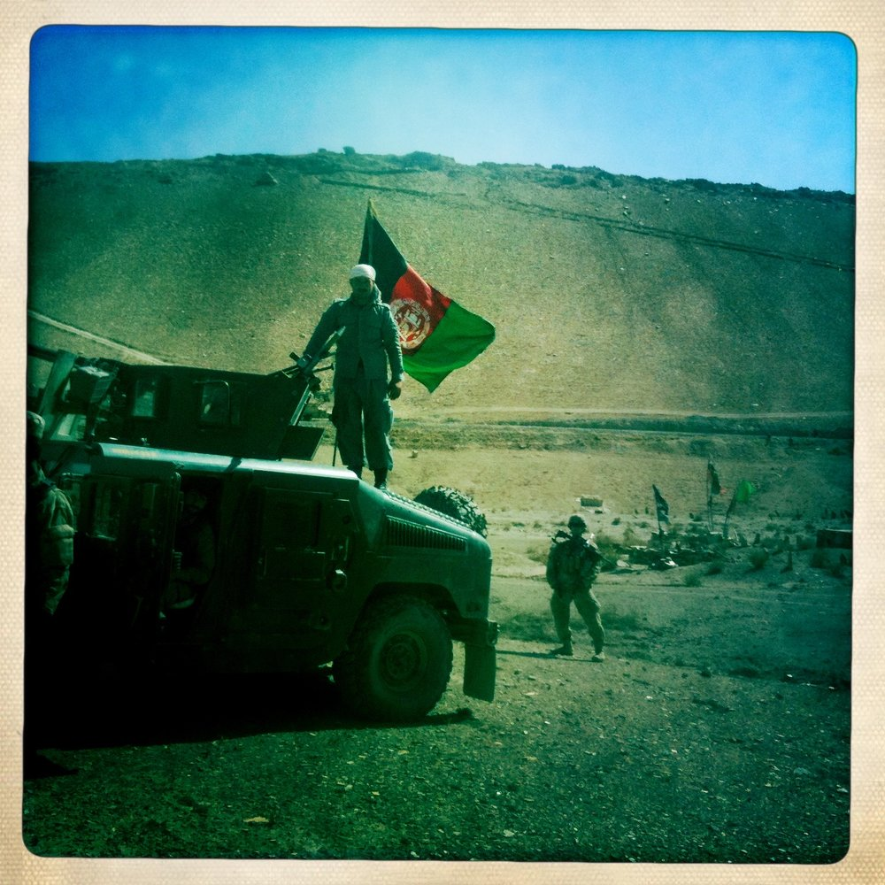 An Afghan National Policeman atop his Humvee. Courtesy of Drew Pham