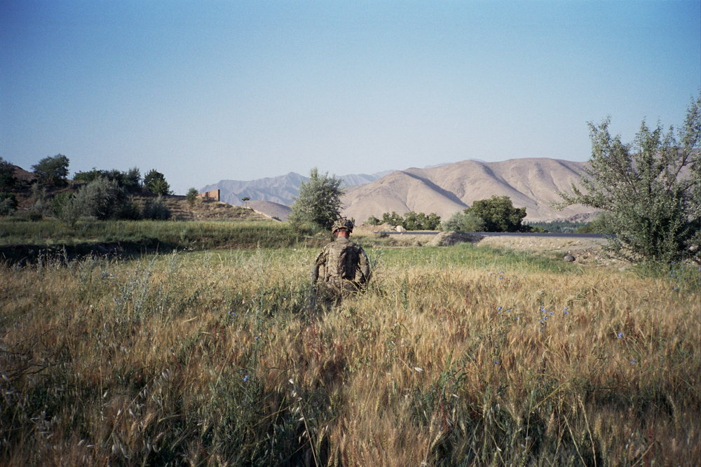 A Tenth Mountain Division soldier on patrol in Wardak Province, Afghanistan. Courtesy of Drew Pham