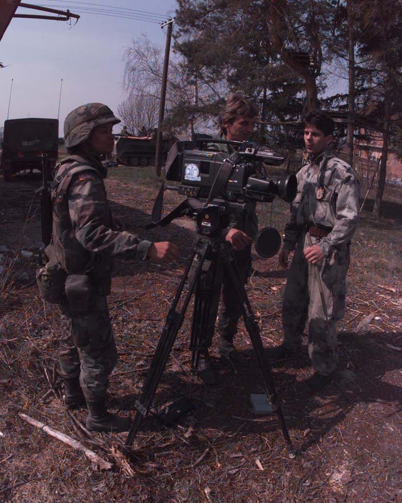 The author preparing to conduct an interview with a Serb soldier and a Bosnian translator. The Serb, along with American troops, had been searching for land mines emplaced during the war along the banks of the Sava River. Courtesy of Luis Iglesias