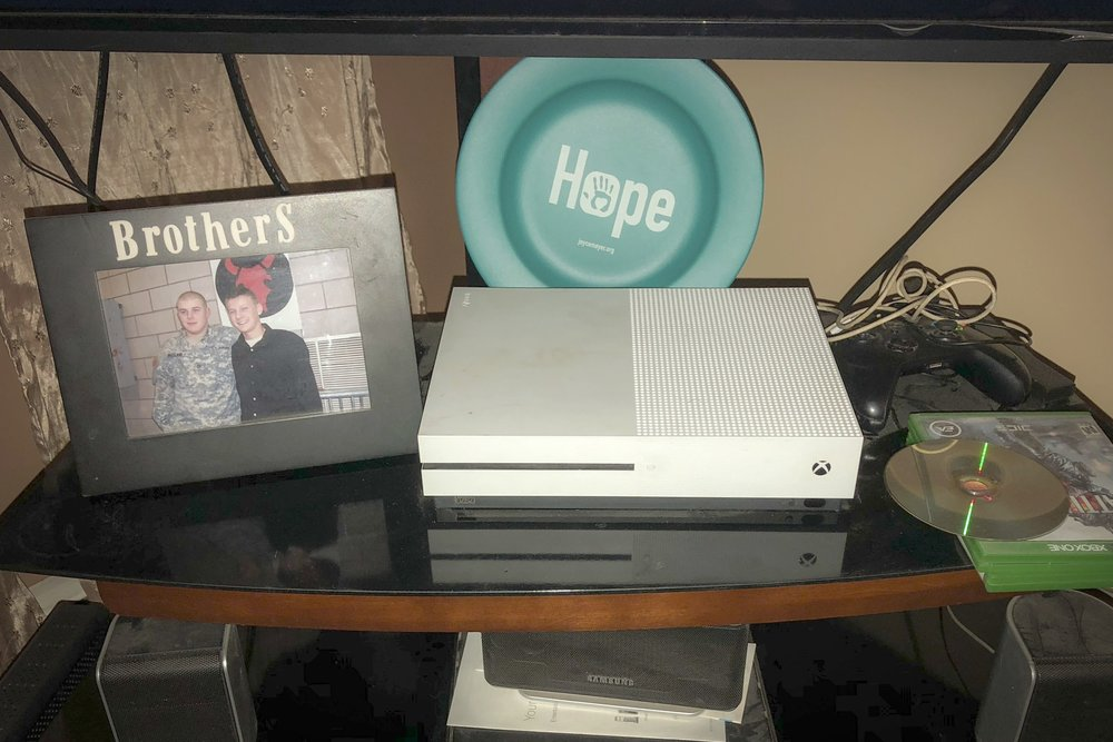 A photo of the two brothers stands next to the Xbox where XX and his elder brother played video games on the days James Belland couldn't go outside. Courtesy of Zach Belland