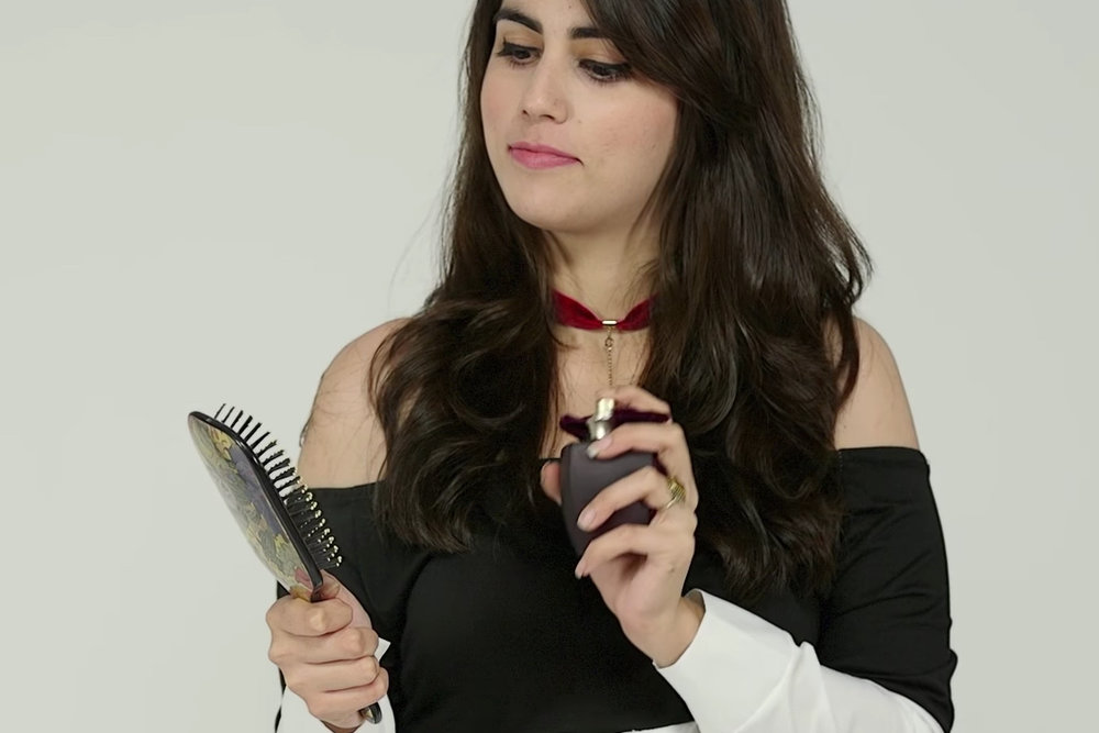 Spraying a small amount of perfume (non-alcoholic) on your hairbrush before running it through your hair, will make your hair smell great too!