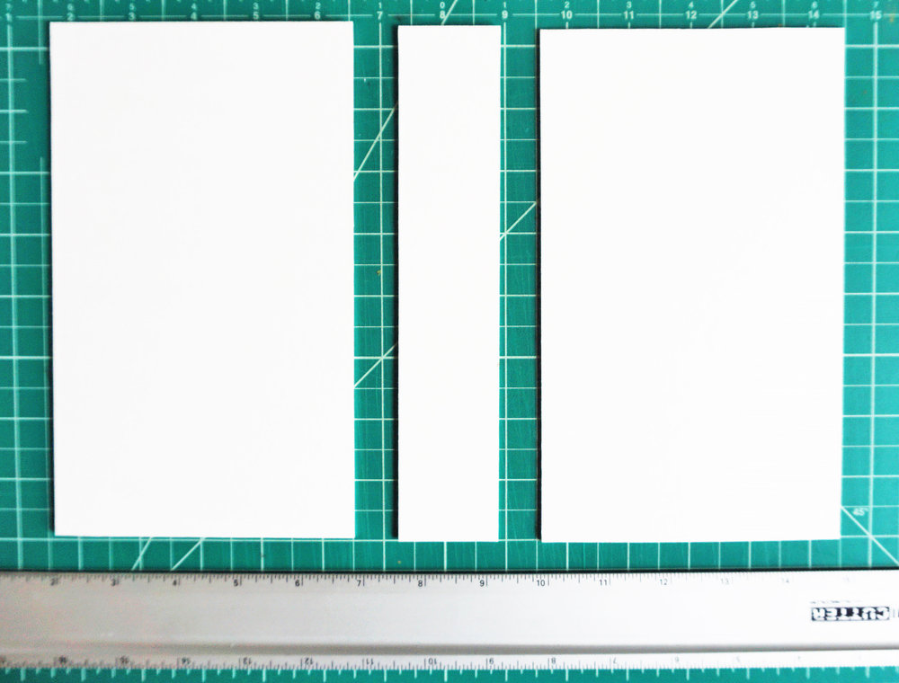 """Lay out your cardboard on a cutting board with .5"""" of space between each sheet."""