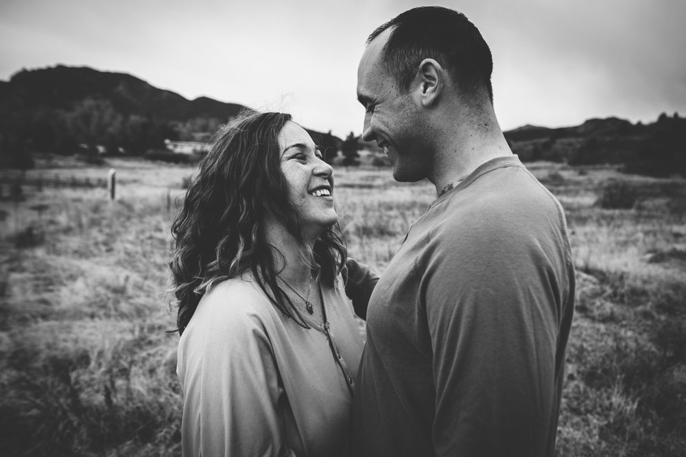 Couple share a loving smile with each other during mountain family session in Colorado Springs.