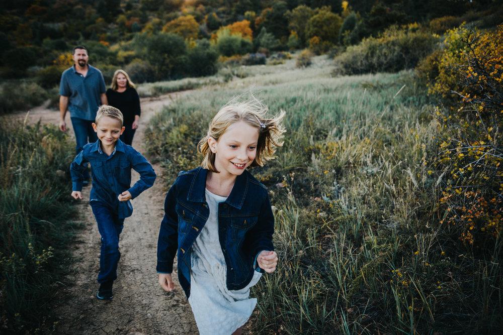 Colorado family enjoys their hike during family photo session in Colorado Springs.
