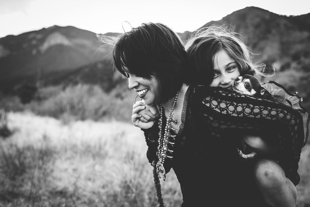 Mother, daughter and their dog enjoy their time in the Colorado Springs mountains during photo session.